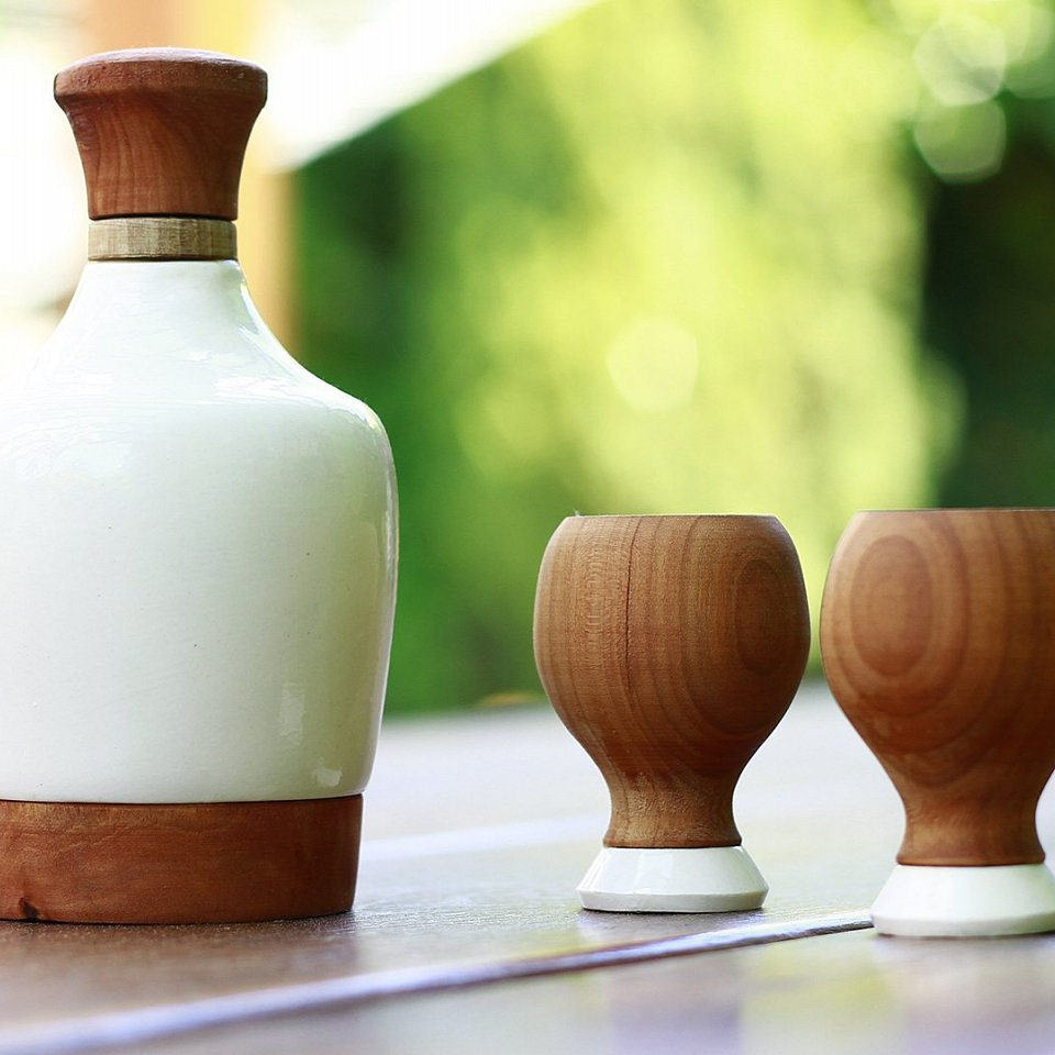 porcelain bottle with wooden shots. Wood material is made from the same plum tree whose plums are used to make the traditional spirit